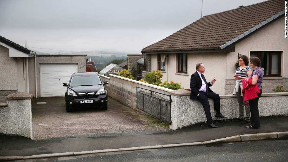 Salmond talks with supporters September 18 in Turriff, Scotland.
