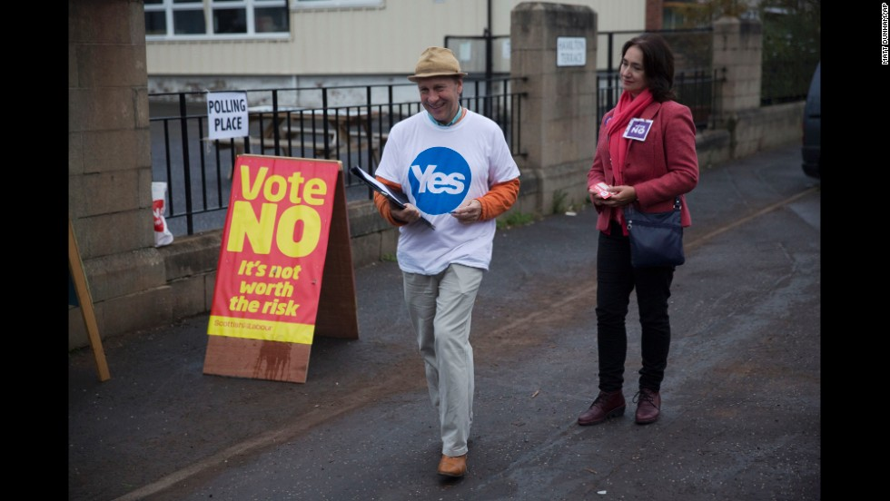 Campaigners stand outside a polling station in Edinburgh on September 18.