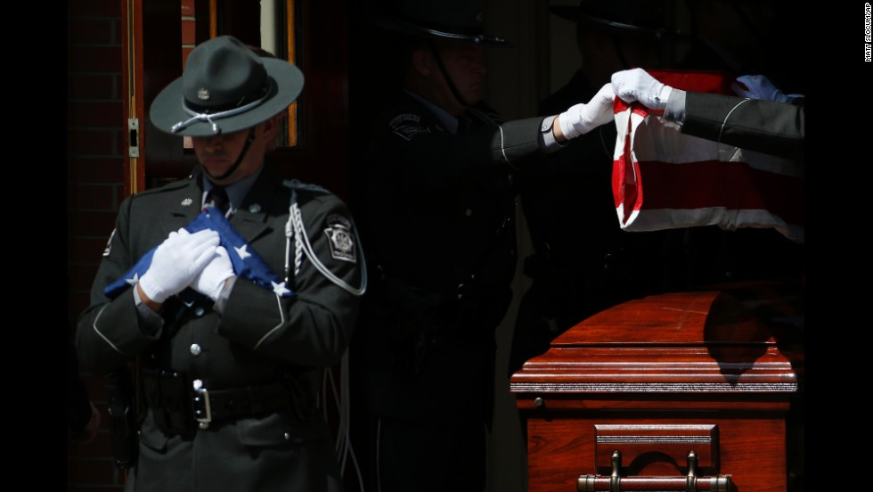 An honor guard folds a flag from Dickson's casket on September 18.