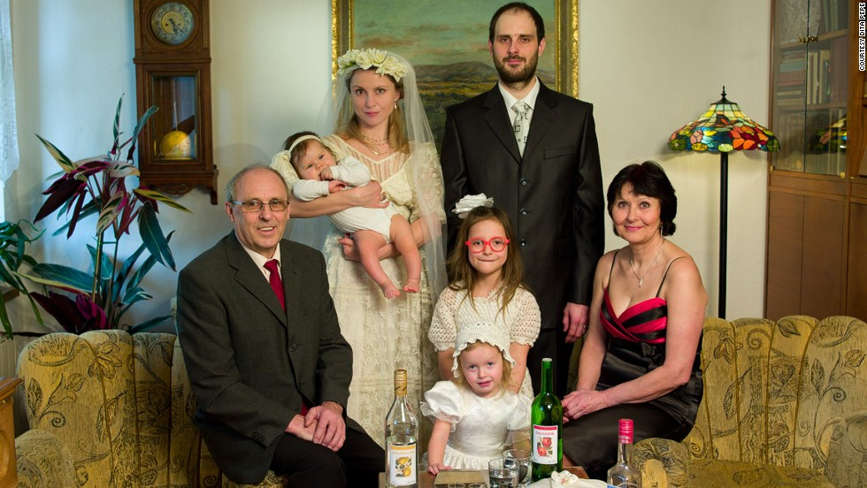 This is <strong>Dita Pepe</strong>. She's the one in the bridal gown. Except this is not her wedding, and this is not her family.  <br /><em><br />Click on the right side of the picture or on the arrows below to uncover the story. </em>