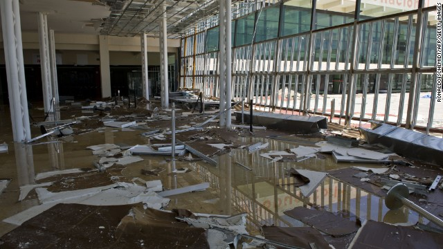 Picture of the damages caused at the airport of San Jose del Cabo, taken on September 16, 2014 a day after hurricane Odile -- which has since been downgraded to a tropical storm -- knocked down trees and power lines in Mexico's Baja California peninsula. Mexico on Tuesday prepared a major operation to airlift tourists stranded by Hurricane Odile after it slammed into the Baja California peninsula causing widespread damage. Military aircraft and commercial airlines were being sent to the hard-hit resort towns of La Paz and Los Cabos, where holiday makers in Odile's path have been hunkering down for two days. AFP PHOTO/RONALDO SCHEMIDT (Photo credit should read RONALDO SCHEMIDT/AFP/Getty Images)
