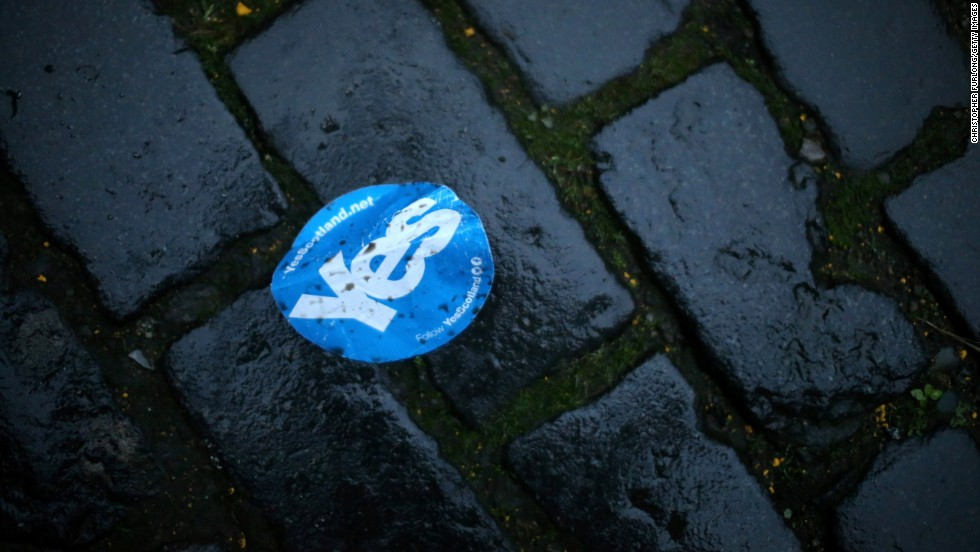 "A discarded ""Yes"" sticker lies on cobblestones along Edinburgh's Royal Mile on September 19."