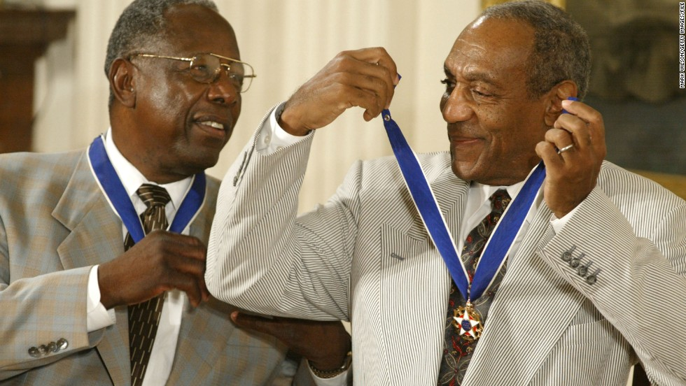 Cosby shares a laugh with baseball great Hank Aaron after they both received the Presidential Medal of Freedom in 2002. The medal is America's highest civilian award.