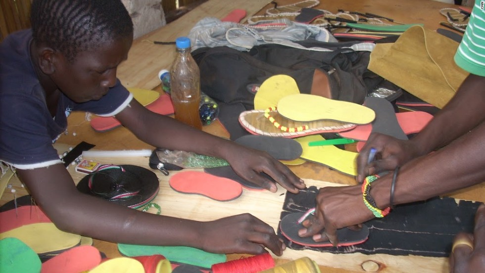 The youngsters work together to design and make the shoes at the Uganda-based center.