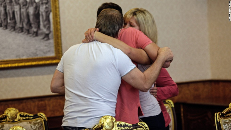 Relatives of Witheridge hug before a police briefing in Bangkok on September 18.