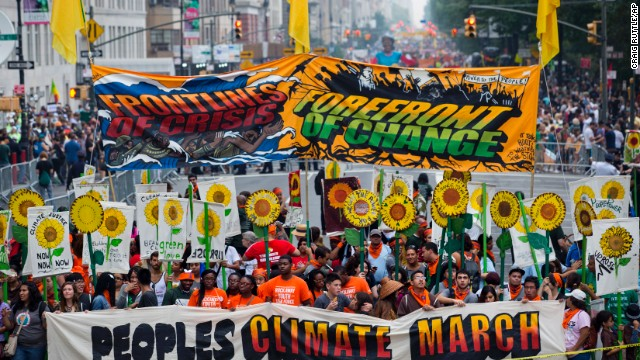 People gather near Columbus Circle before the People's Climate March in New York Sunday, September 21.  People from around the world are participating in what's billed as the largest march ever calling for action on global warming.