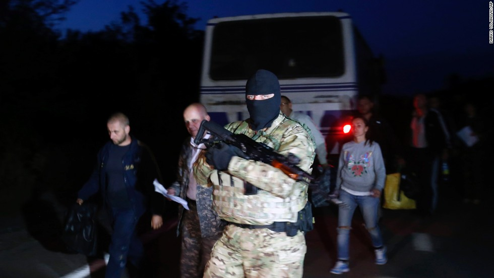 A Ukrainian soldier guards pro-Russian rebels during a prisoner exchange near Donetsk on September 21.