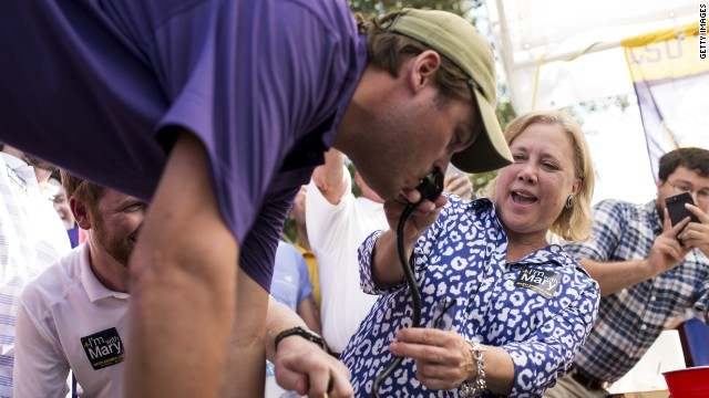 Landrieu helps LSU fan get his drink on