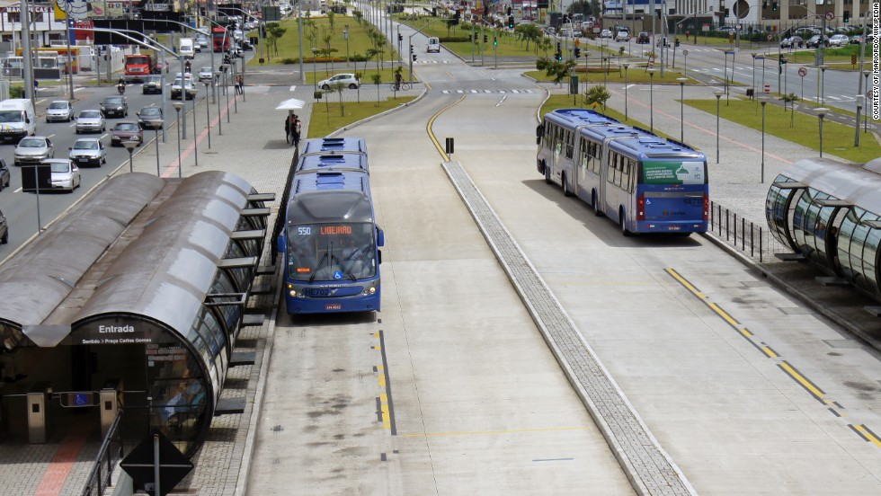 Buses  in Curitiba, Brazil have dedicated lanes in the center of the road and easy-access stop to board. Transfer stations enable smooth transitions between bus lines.