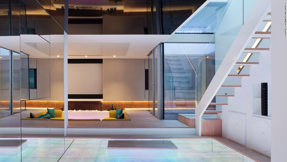 "<a href=""http://www.hogartharchitects.co.uk/"" target=""_blank"">Hogarth Architects</a>-designed Hidden House 's huge finished basement, light-up dance floor and waterfall were featured on the British homes show Grand Designs."