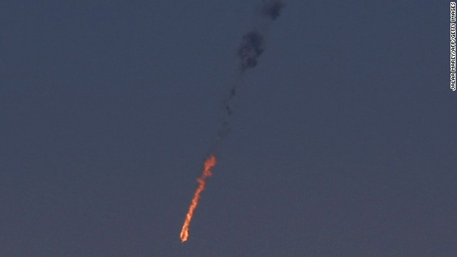 A Syrian fighter jet is in flames Tuesday after being hit by the Israeli military over the Golan Heights.