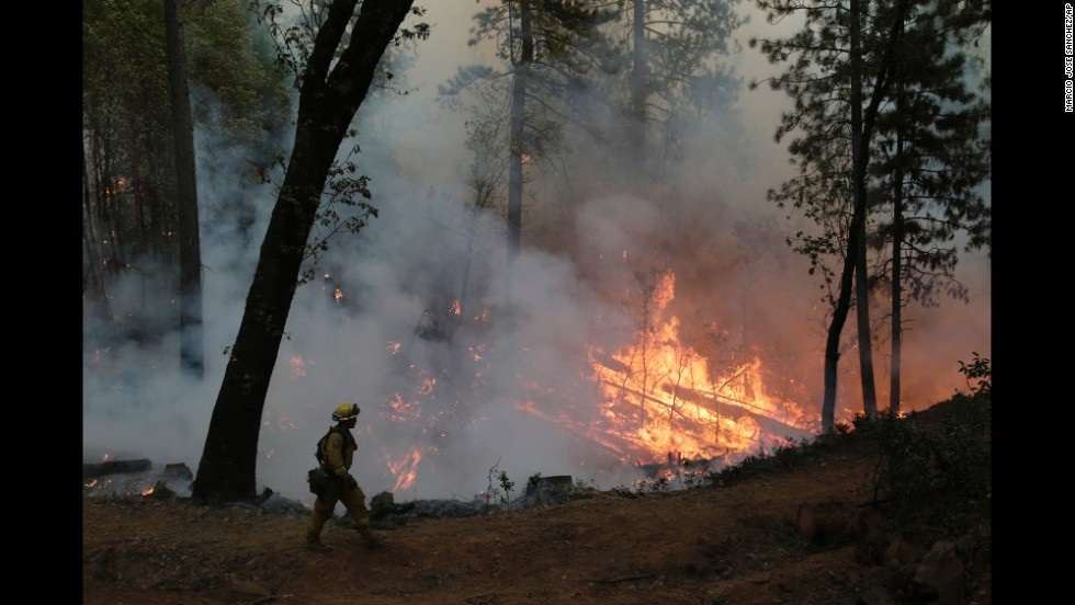 A firefighter walks along the containment line during a controlled burn near Placerville on September 22.