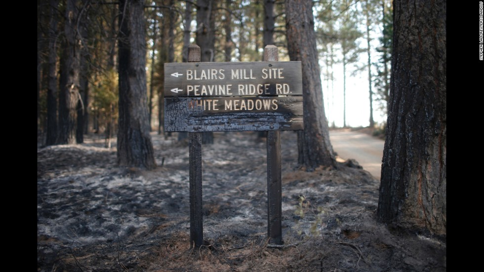 A sign stands half-burned by the King Fire in White Meadows, California, on Saturday, September 20.