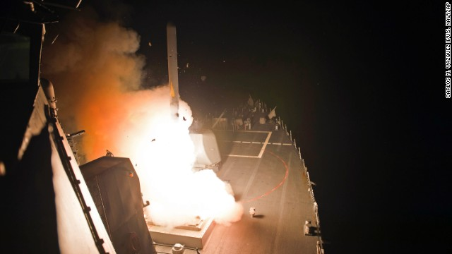 In this photo released by the U.S. Navy, the guided-missile destroyer USS Arleigh Burke (DDG 51) launches Tomahawk cruise missiles, in the Arabian Gulf, Tuesday, Sept. 23, 2014.
