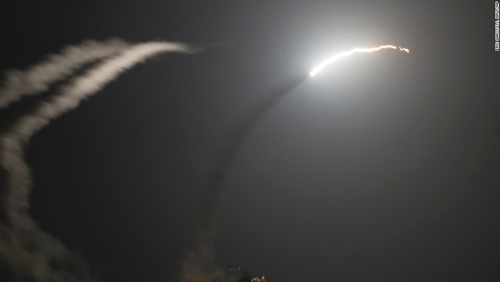 Tomahawk missiles fired by the USS Philippine Sea fly in the air above the Persian Gulf on September 23.