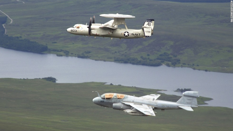 EA-6B Prowlers are among the U.S. aircraft that took off from the USS George H.W. Bush during attacks on ISIS. The Prowler is used to support attack aircraft by jamming enemy radar and communications and obtaining tactical intelligence. Here, a Prowler -- seen at bottom -- flies in formation with an E-2C Hawkeye in June 2004.