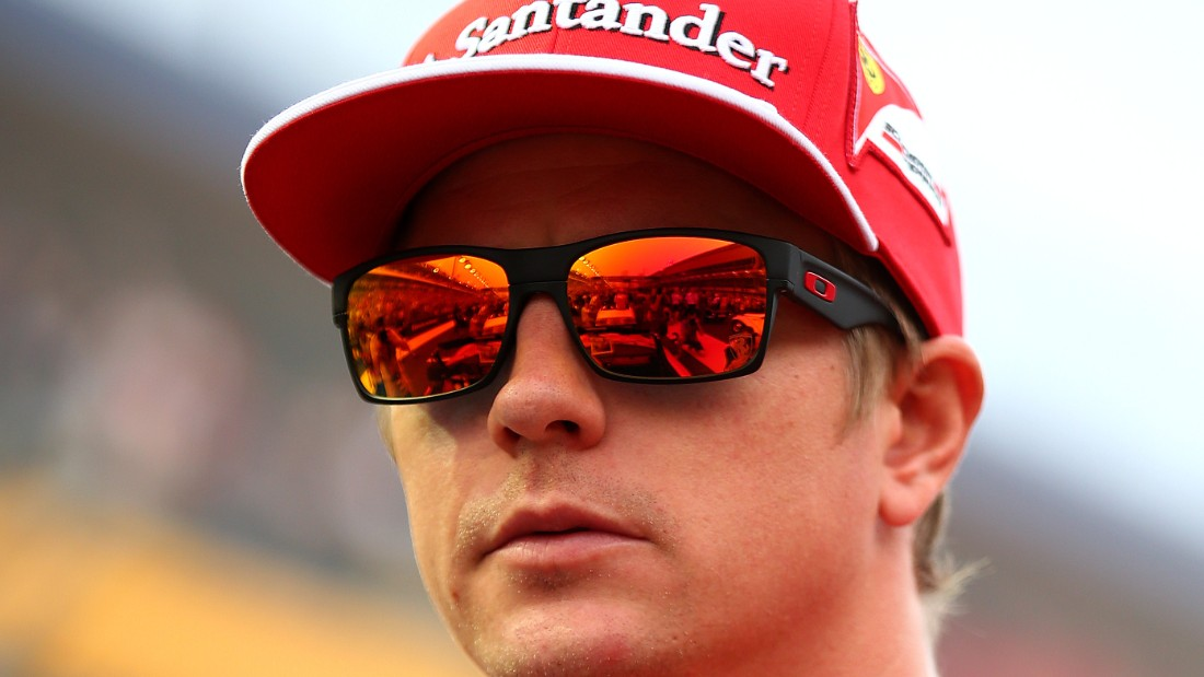 SINGAPORE - SEPTEMBER 21: Kimi Raikkonen of Finland and Ferrari takes part in the drivers' parade before the Singapore Formula One Grand Prix at Marina Bay Street Circuit on September 21, 2014 in Singapore, Singapore. (Photo by Mark Thompson/Getty Images)