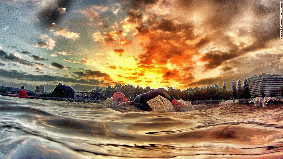 This photograph by Crowhurst almost has a volcanic feel about it, setting the swimmer against the backdrop of the fiery red sun setting in the distance.