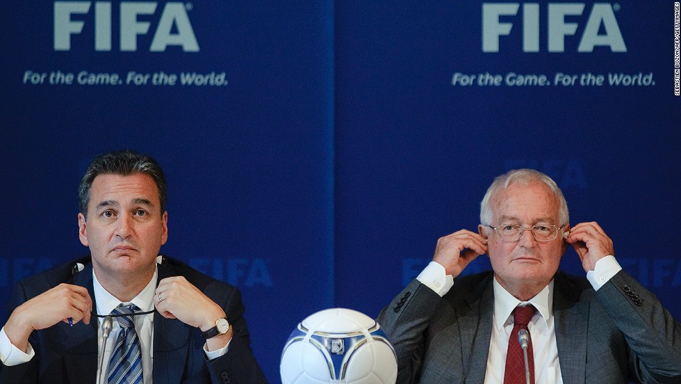 Michael Garcia (left) handed his report on the bidding process for the 2018 / 2022 World Cups to the FIFA Ethics Committee. Garcia has also called for the findings of his report to be made public.