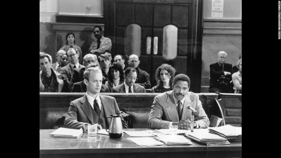 "<strong>""Philadelphia"" (1993)</strong>: The wonder of a Washington performance is that he can play an abrasive character and not make you hate him (at least, not completely). In ""Philadelphia,"" the story of a lawyer (Tom Hanks, foreground left) who sues when his firm discriminates against him for his HIV status, Washington plays the attorney who represents him and who is as bigoted (initially, at least) as the lawsuit's defendants."
