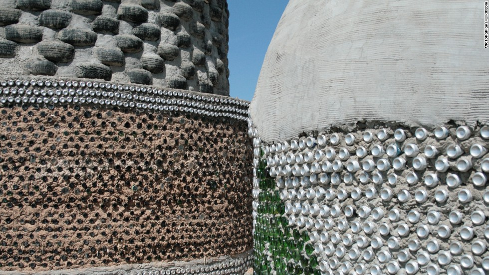 Tires, cans and bottles are mixed with concrete to make different walls for the earthships.