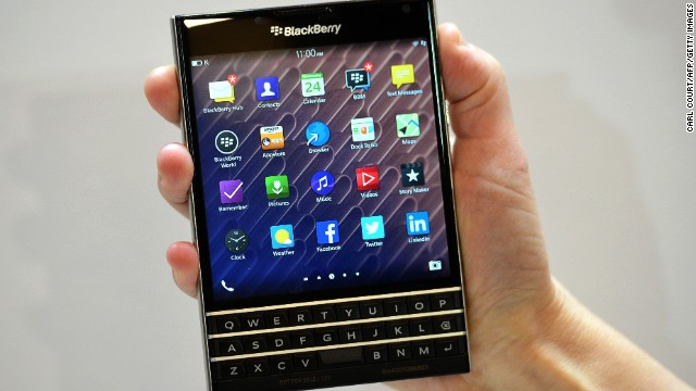 A woman holds the Blackberry Passport smartphone during at a simultaneous launch event in London on September 24, 2014. BlackBerry on Wednesday unveiled its newest smartphone with a full physical keyboard and a large screen, aiming to return to its roots targeting business users. The BlackBerry Passport, named for its approximate size to the travel document, is designed to win back key corporate users after the struggling Canadian company was effectively knocked out of the highly competitive consumer smartphone market dominated by Apple and Samsung. AFP PHOTO / CARL COURT        (Photo credit should read CARL COURT/AFP/Getty Images)