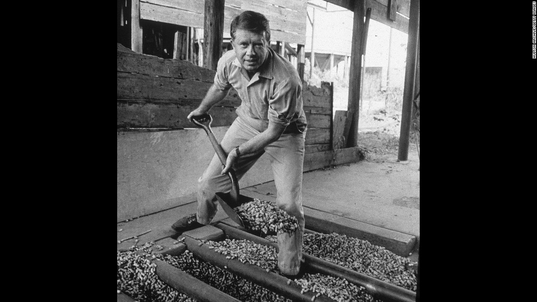 Carter shovels peanuts in the 1970s. Carter was the son of a peanut farmer, and he took over the family business in 1953 before his political career took off.