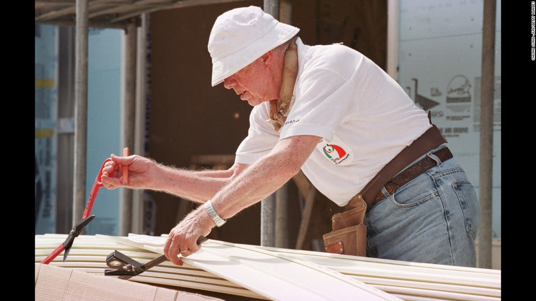 Carter works at a construction site sponsored by the Jimmy Carter Work Project in Asan, South Korea, on August 6, 2001. The Carters have been involved with the nonprofit Habitat for Humanity since 1984.