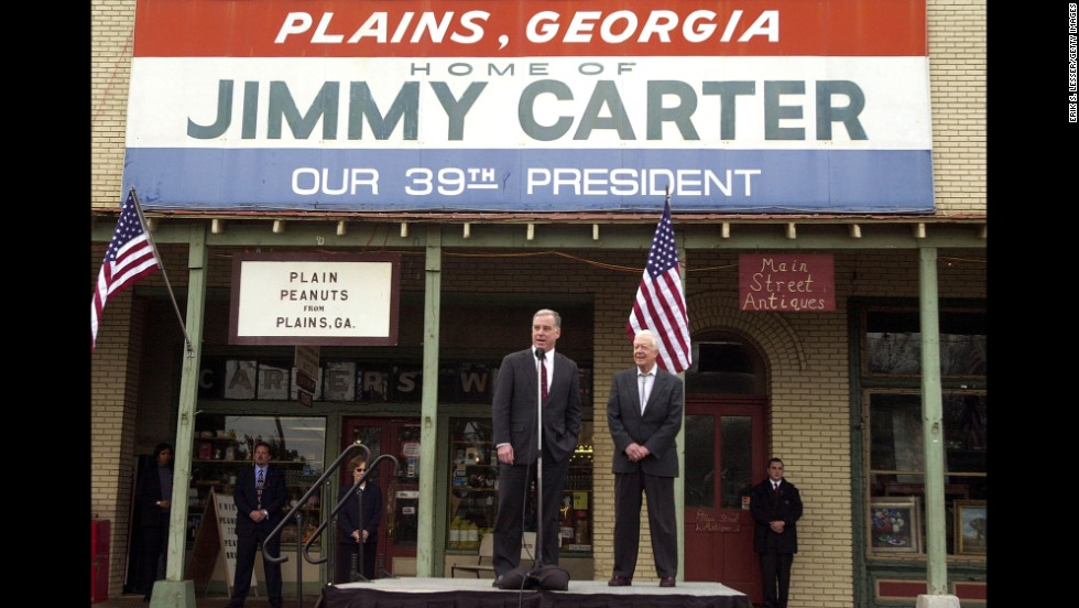 Democratic presidential candidate Howard Dean speaks beside Carter during a campaign stop in Plains, Georgia, in January 2004.