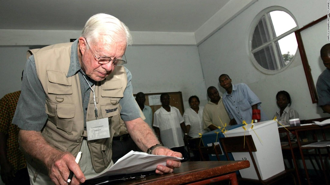 Carter checks his notes while observing a polling station in Maputo, Mozambique, in December 2004. Since 1989, the Carter Center has been observing elections around the world to determine their legitimacy. The nonprofit organization was founded by Carter and his wife to advance human rights across the globe.