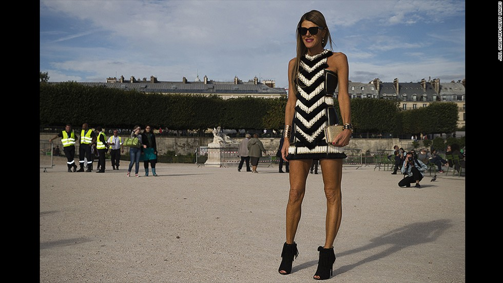 Vogue Japan's Italian editor-in-chief Anna Dello Russo struck a fierce pose on her way to the Nina Ricci show.