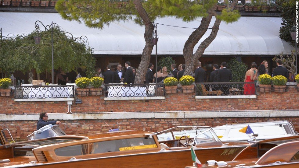 Guests attend a cocktail party at the Hotel Cipriani before the wedding.