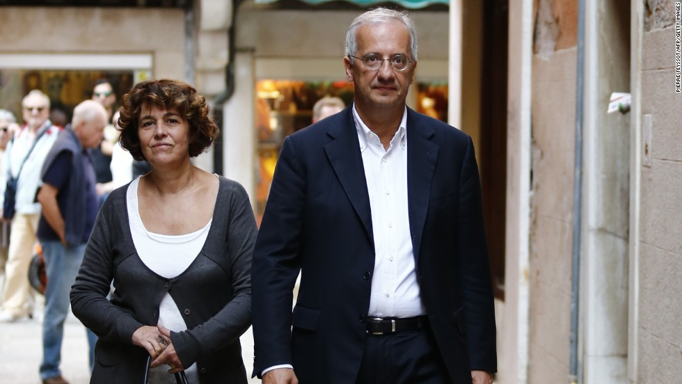 The former mayor of Rome, Walter Veltroni, and his wife, Flavia Prisco, arrive for the wedding.