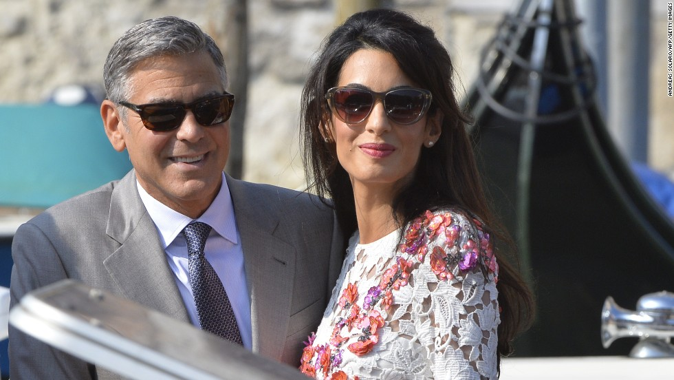 "Actor George Clooney and his wife, attorney Amal Alamuddin, stand on a taxi boat on the Grand Canal in Venice, Italy, on Sunday, September 28. Clooney and Alamuddin <a href=""http://www.cnn.com/2014/09/29/showbiz/italy-george-clooney-wedding/index.html"">married in Venice</a> the previous day at a private ceremony attended by celebrities."