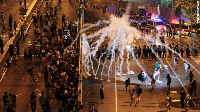 Riot police fire tear gas on student protesters occupying streets around government headquarters buildings in Hong Kong on Monday, September 29.