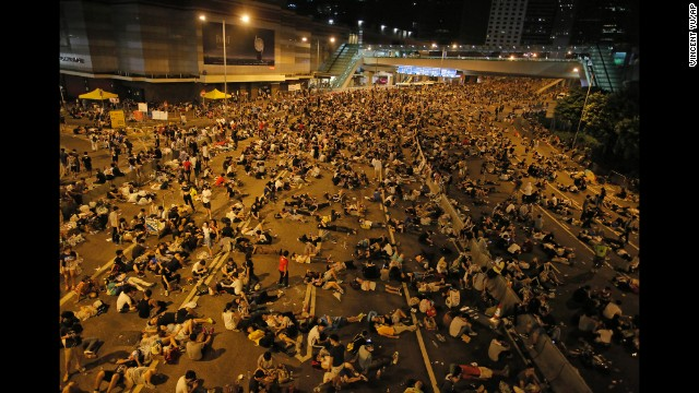 Protesters occupy a main road in the financial central district of Hong Kong after riot police used tear gas against them on Sunday, September 28.