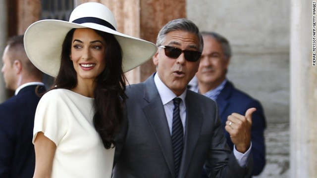 Caption:US actor George Clooney and British lawyer Amal Alamuddin arrive on September 29, 2014 at the palazzo Ca Farsetti in Venice, for a civil ceremony to officialise their wedding. AFP PHOTO / PIERRE TEYSSOT (Photo credit should read PIERRE TEYSSOT/AFP/Getty Images)