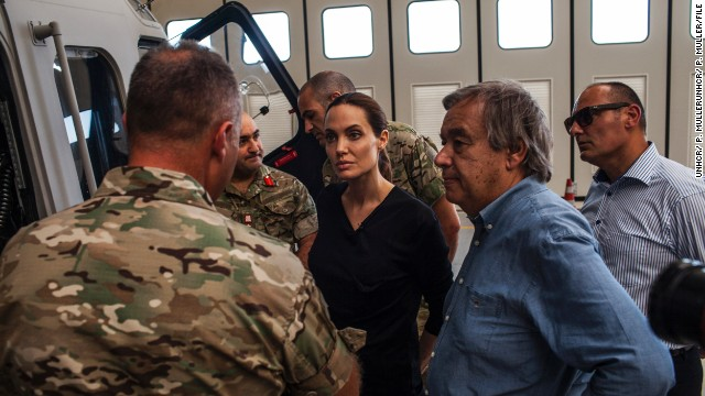 Malta/ Special Envoy for the United Nations High Commissioner for Refugees, Angelina Jolie, listens to officers in the Maltese military discuss rescue at sea operations for refugees at a military base in Valetta, Malta on Sunday, September 14, 2014. Since the start of 2014, more than 2,500 asylum seekers have perished trying to cross the Mediterranean./ UNHCR/ P. Muller/ September 2014