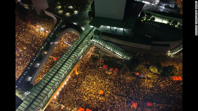 Protesters take part in a rally on a street outside of the Hong Kong Government Complex on Tuesday, September 30.