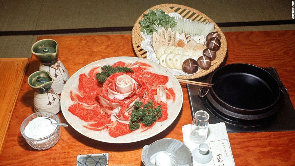 Sukiyaki simmers thin slices of beef in a pot with vegetables, usually bathed in a sauce made with soy sauce, sugar and sake.