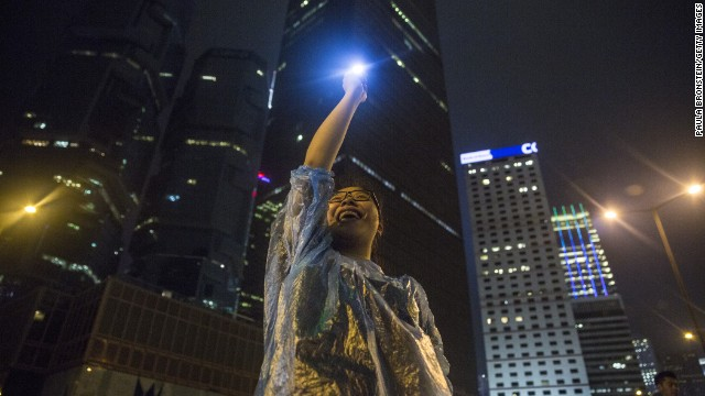 Sofia, 21, chants pro-democracy slogans on the streets on September 30, 2014 in Hong Kong, Hong Kong.