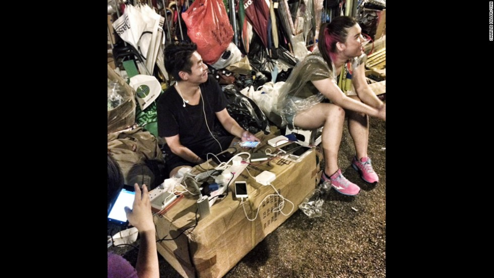 The importance of the smartphone in the Hong Kong protests was understood from the beginning. Here pro-democracy protesters charged phones at a makeshift street charging point in Hong Kong's Admiralty district.