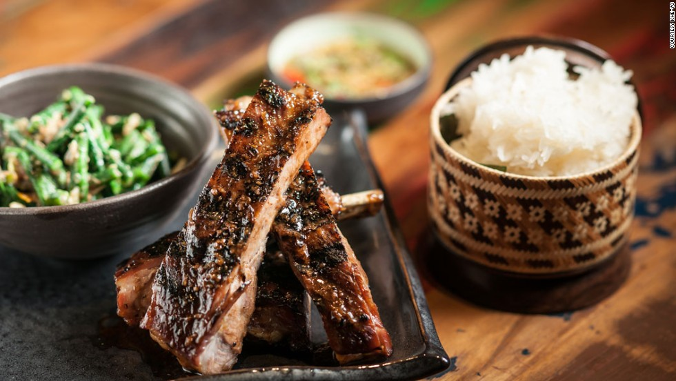 New York City restaurant Khe-Yo serves Laotian-inspired Southeast Asian cuisine. On the dinner menu: Berkshire spare ribs (ping sien moo) with sticky rice and a long bean and cherry tomato salad.