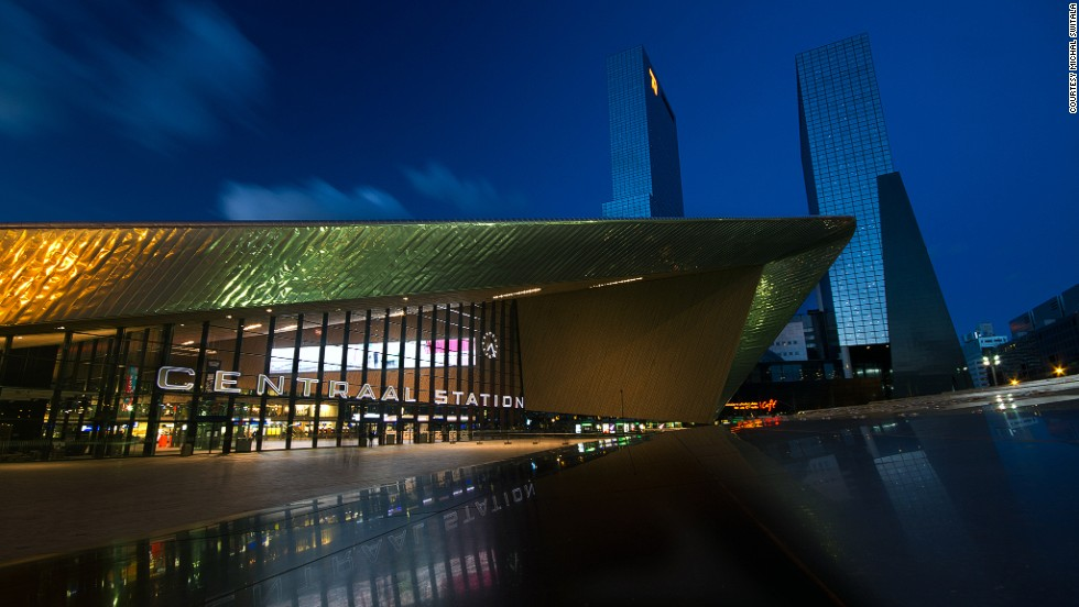 The centerpiece of Netherlands' Rotterdam Centraal Station's design is the main entrance. The shiny boomerang-like canopy is made of a stainless steel projection and wood cladding.