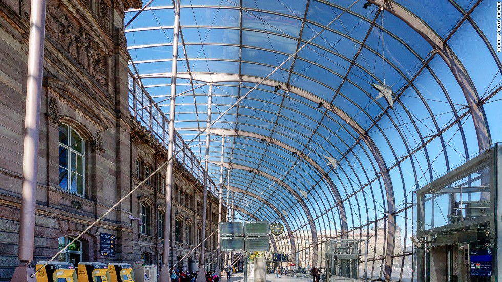 A giant canopy of curved glass covers the 1880s facade of France's Gare de Strasbourg, giving the station the look of a dazzling jewel from the outside.