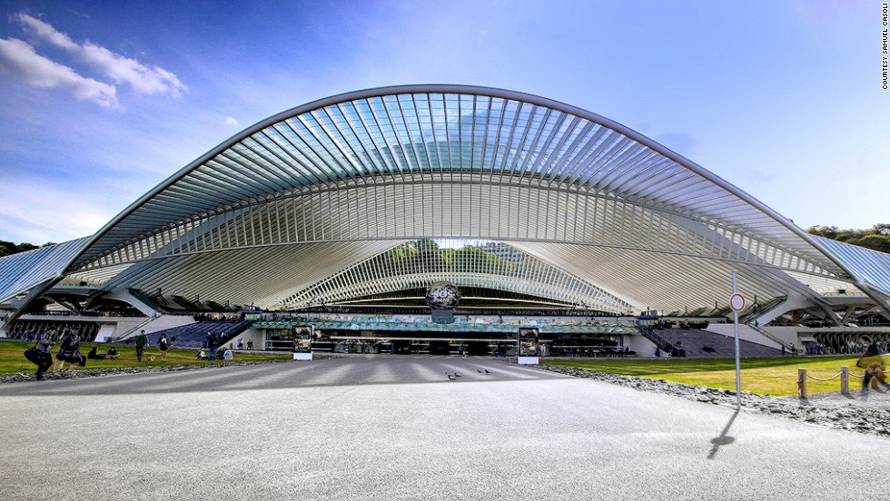 The Liege-Guillemin station in Liege, Belgium features an ultra-modern glass and steel facade. The wave-like ribbed roof suggests movement over the thousands of commuters that flow under it daily.
