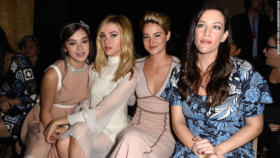 Beautiful ladies of film - rising stars Hailee Steinfeld, Nicola Peltz and Shailene Woodley sit next to movie siren Liv Tyler at the Miu Miu show