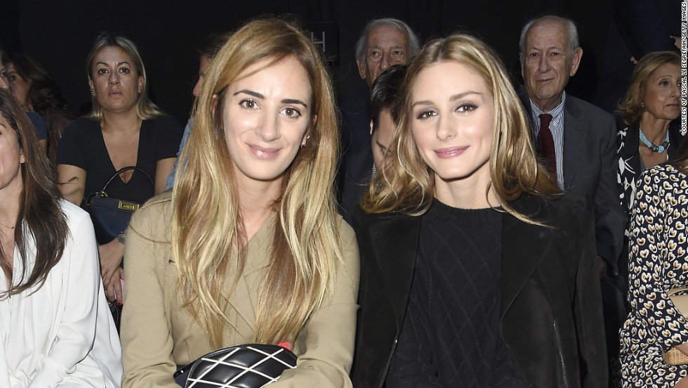 Alexia Niedzielski (founder of System Magazine) and Olivia Palermo attend the Moncler Gamme Rouge show, wearing luxurious neutrals.