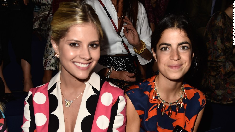 Lala Rudge and Leandra Medine (of the infamous blog Man Repeller) attend the Valentino show wearing striking colorful prints.