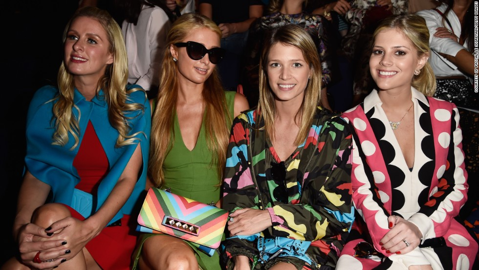 Paris Hilton and Nicky Hilton make an appearance at the Valentino show, snuggling next to Helena Bordon and Lala Rudge.